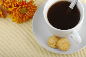 Blacktea with biscuits and orange flower (Selective Focus)