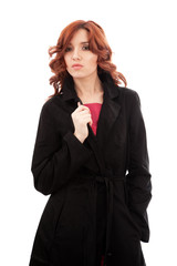 Young woman in black raincoat
