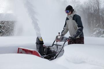 snow blowing man