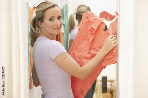 Woman Looking at Dress