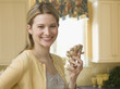 Woman Holding Ginseng in the Kitchen