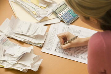 Woman Filling Out Tax Form