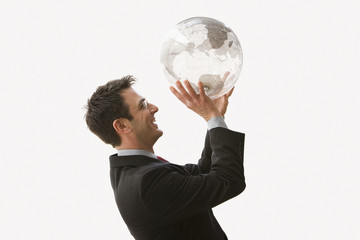 Smiling Businessman Holding Globe Like a Basketball - Isolated
