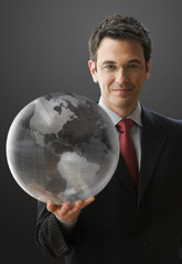 Smiling Businessman Holding a Globe