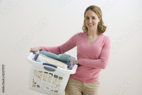 Woman Holding Laundry Basket
