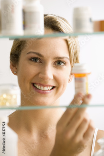 Woman Looking in Medicine Cabinet
