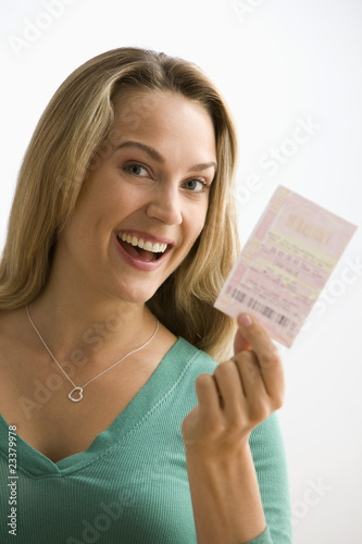 Woman Holding Lottery Ticket
