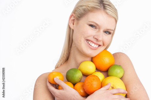 Young Woman Holding Citrus Fruit In Studio