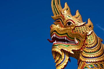 gold snake with blue sky