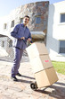 Man carrying card boxes