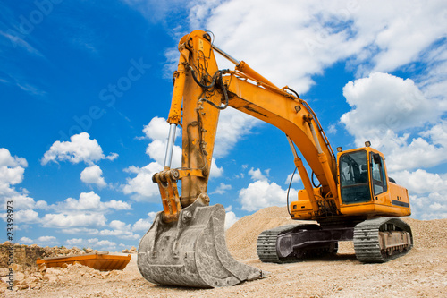 Yellow Excavator at Construction Site - 23398973
