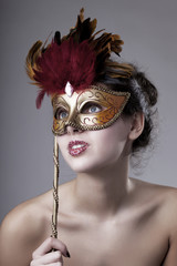 Beautiful girl with a carnival mask