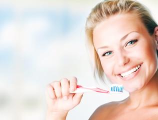 Beautiful Girl Brushing her Teeth