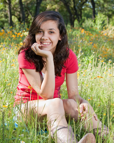 pretty teen girl in a field of wildflowers stock photo
