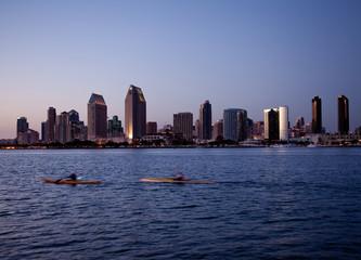 San Diego skyline on clear evening with kayaks