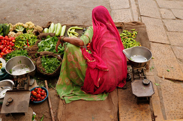 Indian Colorfully women seling vegetables on the street
