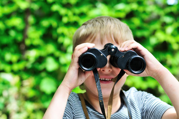 Boy looking through binocular