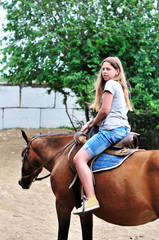 teen girl riding horse