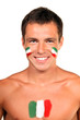 Portrait of an italian fan with flag on his body and face