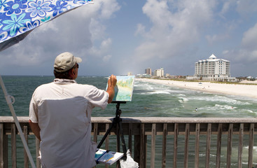 Artist Painting Shorefront