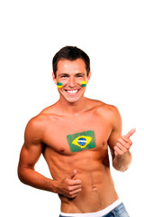 happy brazilian fan with flag on his body and face