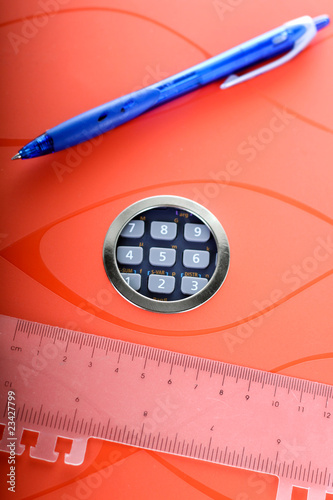 notebook, calculator, blue pen and a transparent line