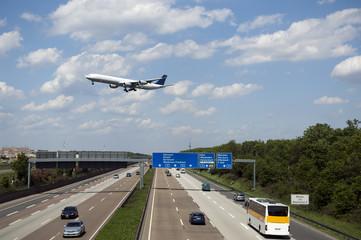 German Highway Autobahn near Frankfurt with crossing jet