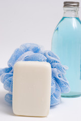 loofah and soap bottle