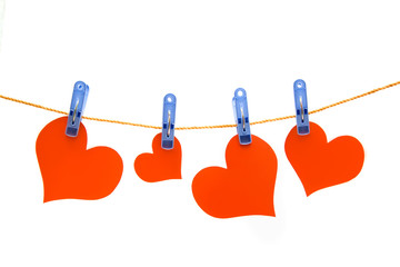 Four hearts drying on the rope