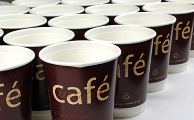 Row of cafe paper coffee cups