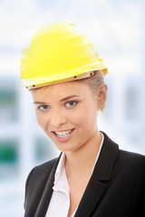 Confident female worker in helmet