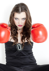 portrait of young woman with boxing gloves