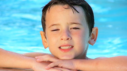 Young Boy in Family Swimming Pool  60FPS