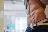 Athletic man with six-pack abs poster