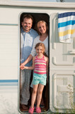 Family in camper on summer vacation poster