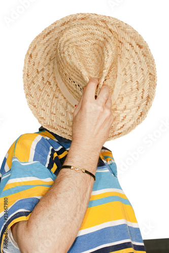 Portrait of a man while taking off his straw hat
