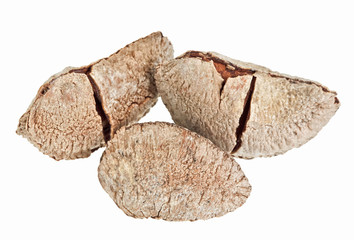 Few whole shelled Brazil nuts isolated on white