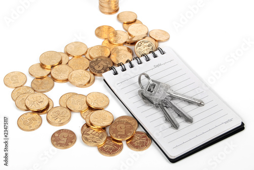 key & notebook and coins