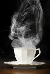 Cup with coffee with steam
