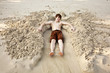 boy  is lying in a sandy bed at the beautiful beach