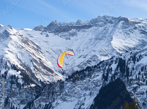 Paragliding in alps mountains