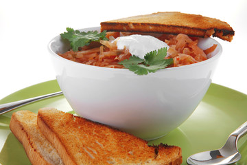 red soup and bread