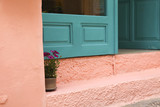 Bright turquoise green with pink wall in Greece