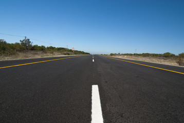 road with blue sky above