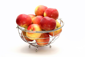 Red apples in metal basket on white background