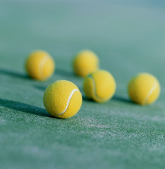 tennis balls on the lawn