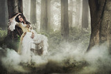 Fototapety gorgeous lady in a mysterious foggy forest