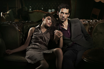 Handsome couple sitting on sofa
