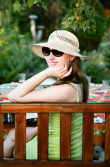 Cute fashin woman at sunglasses relaxing at picnic