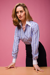 Authoritative woman in striped shirt